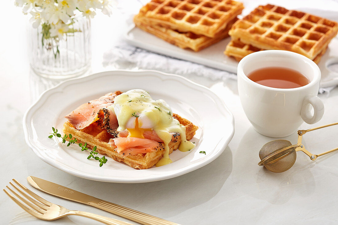 Waffle with Smoked salmon and opened poached egg