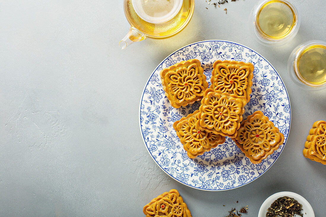 Traditional Chinese mooncakes for mid autumn festival with egg yolk and bean paste filling overhead view
