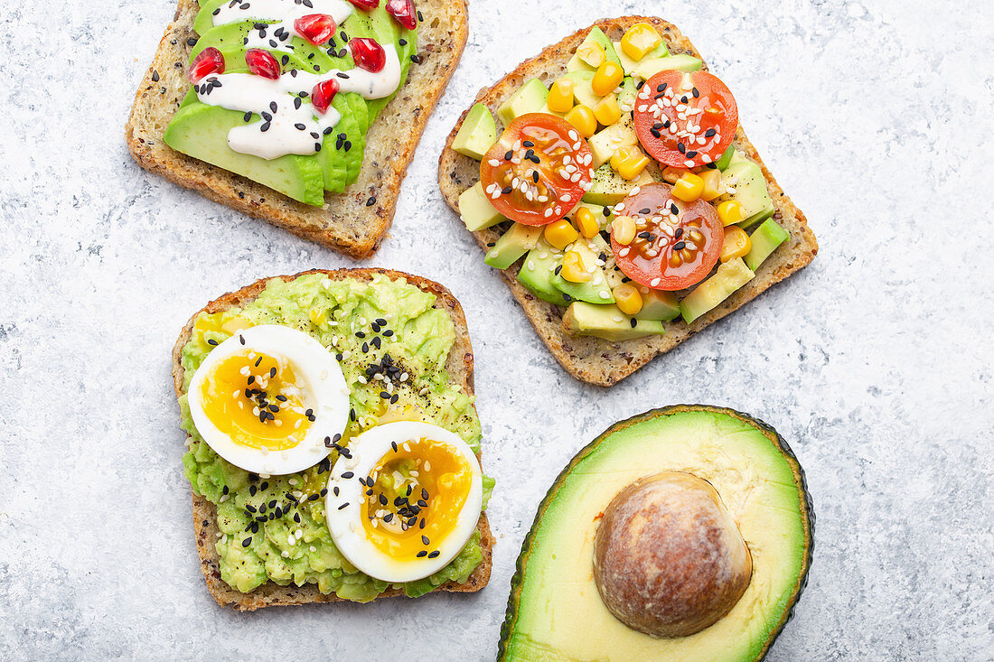 Clean eating - avocado toasts with egg, tomatoes and seasonings