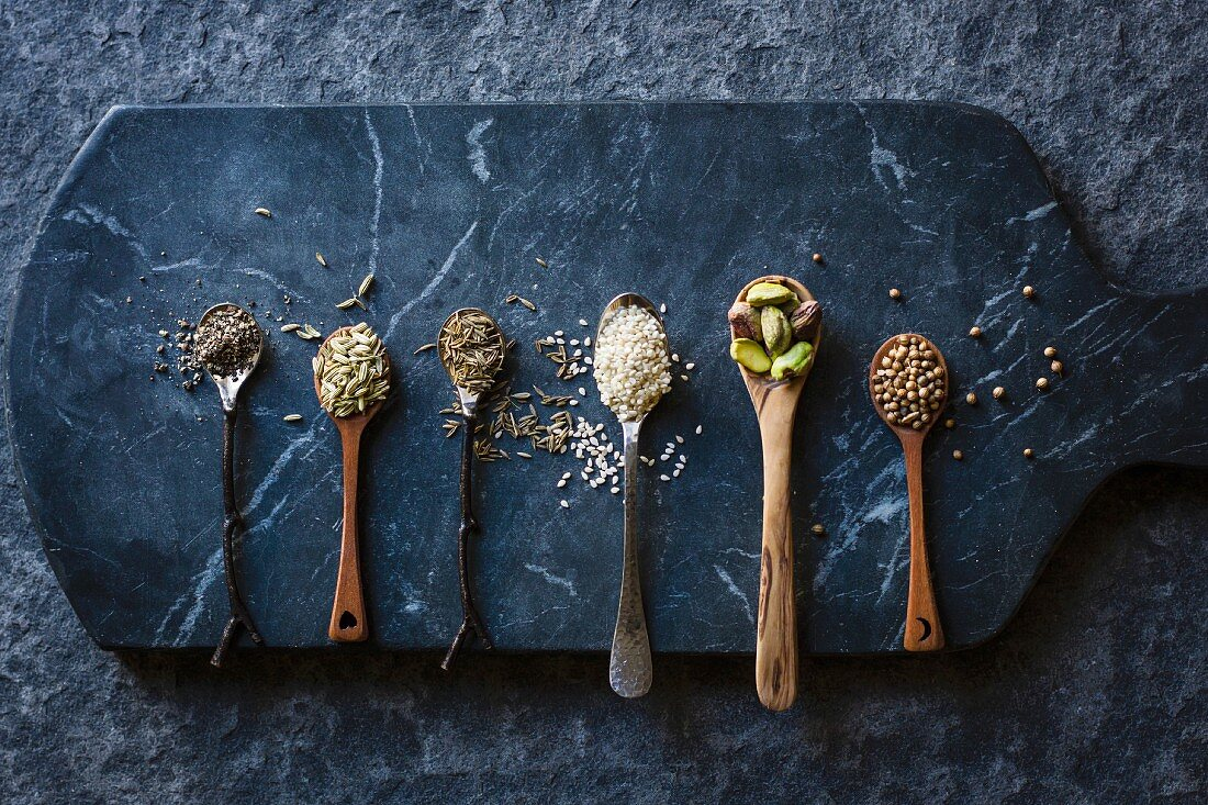 Grains, seeds and nuts on spoons