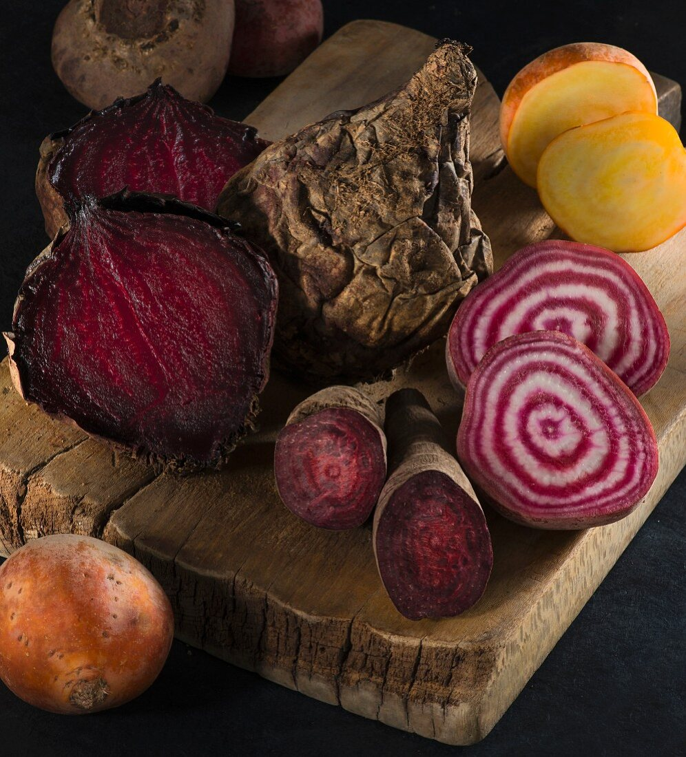 Red, yellow and striped beetroot on a wooden board