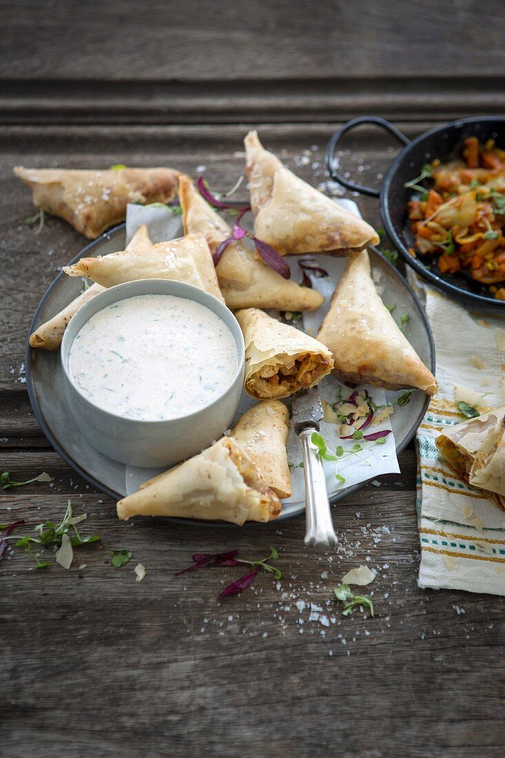 Spicy chicken, atchar and Brie samosas with a sour cream and coriander dip