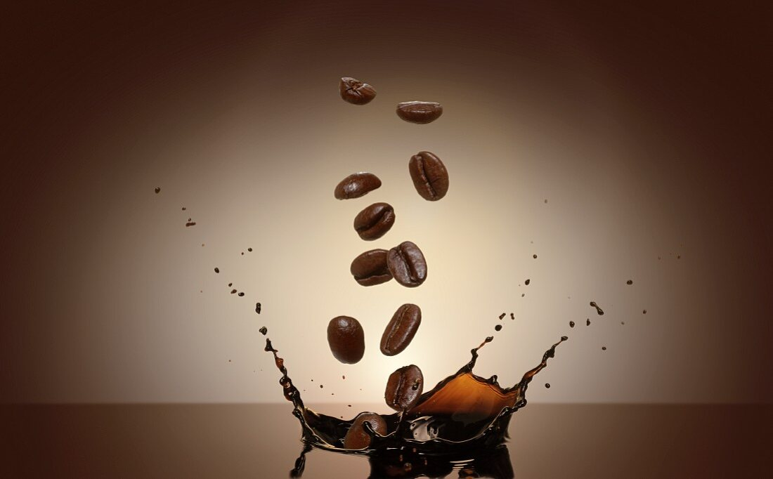 Coffee beans falling into coffee