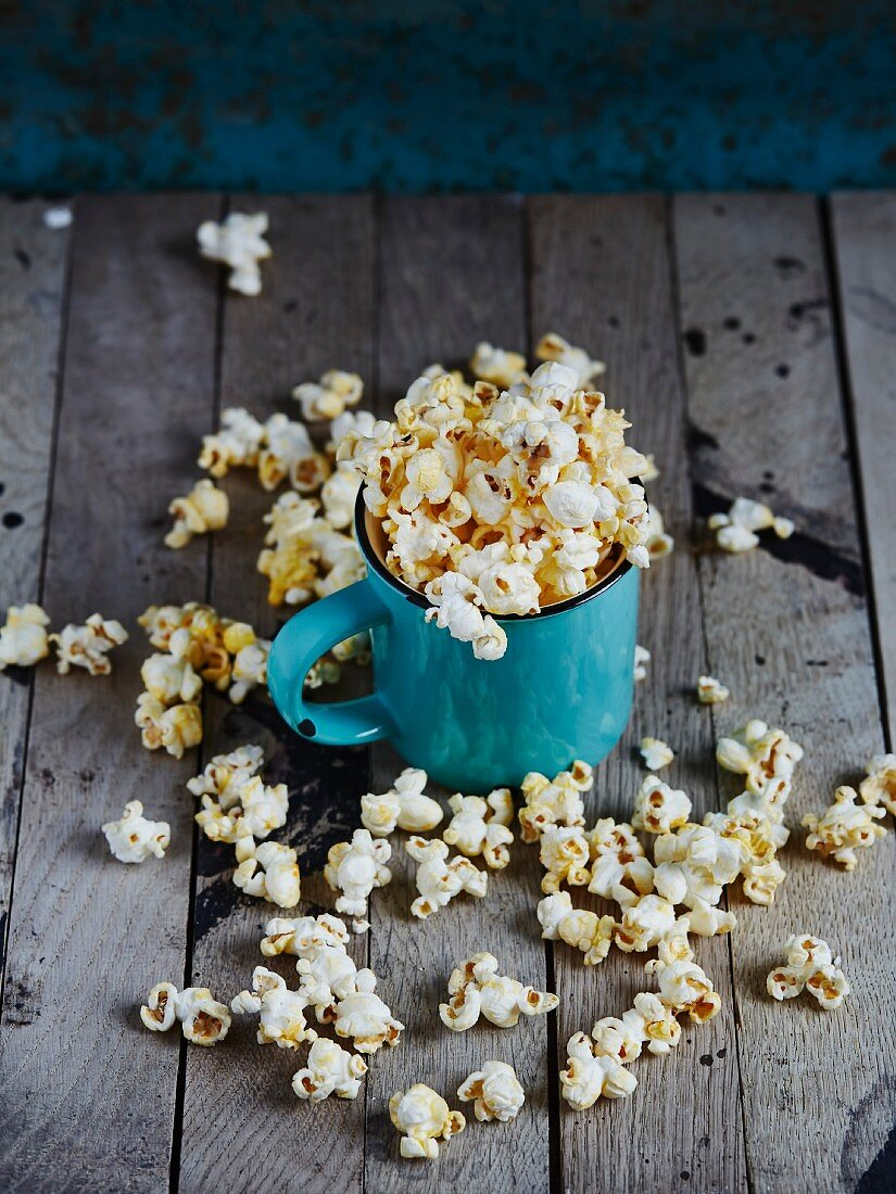 Blue cup full of popcorn
