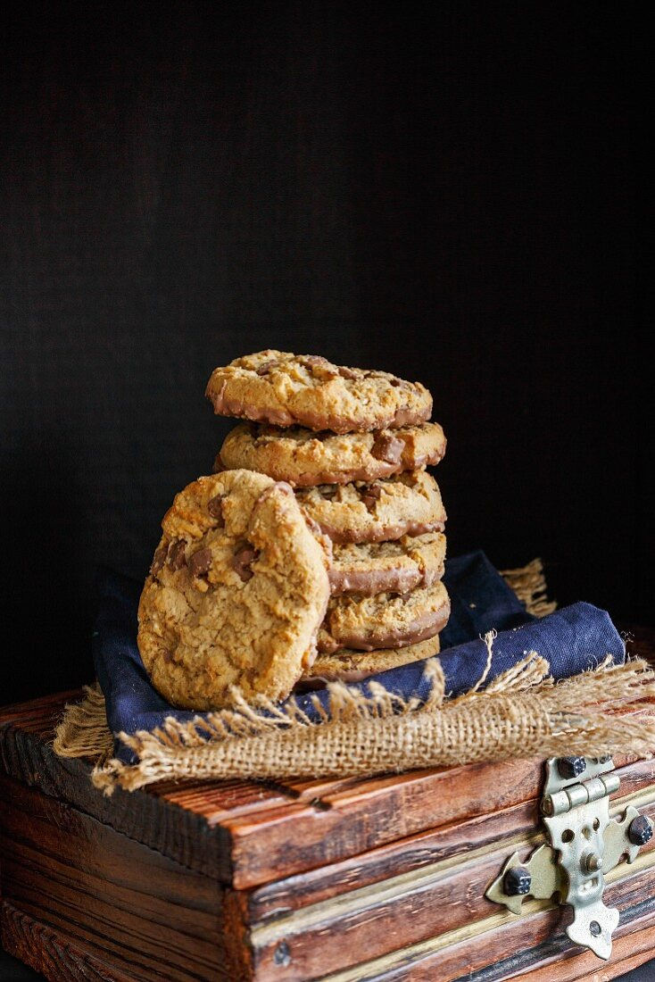 Stack of Chocolate chunk Cookies on a dark rustic background
