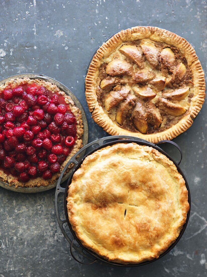 Three Assorted Fruit Pies with Slices Removed