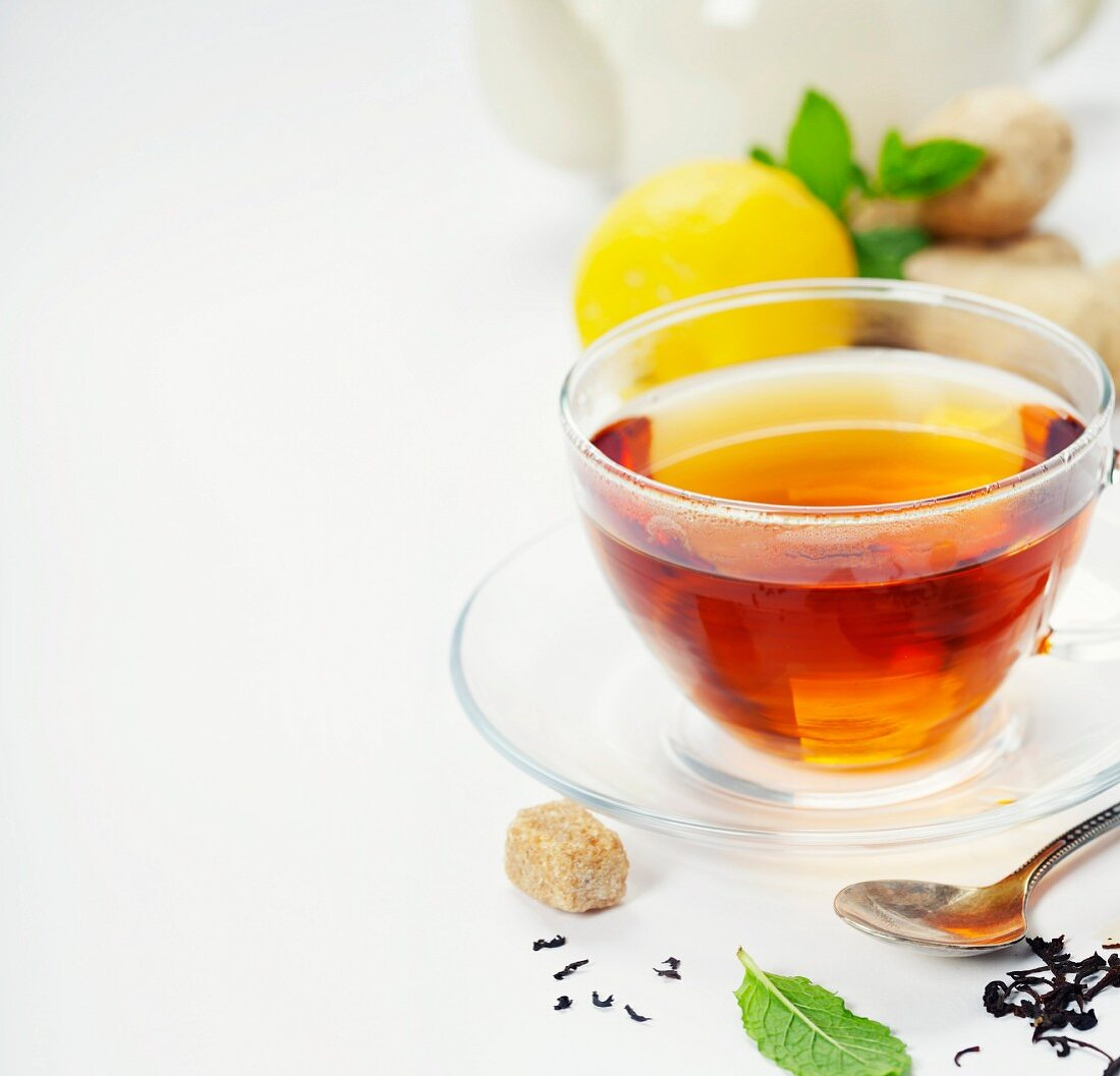 Tea with mint, ginger and lemon on white background