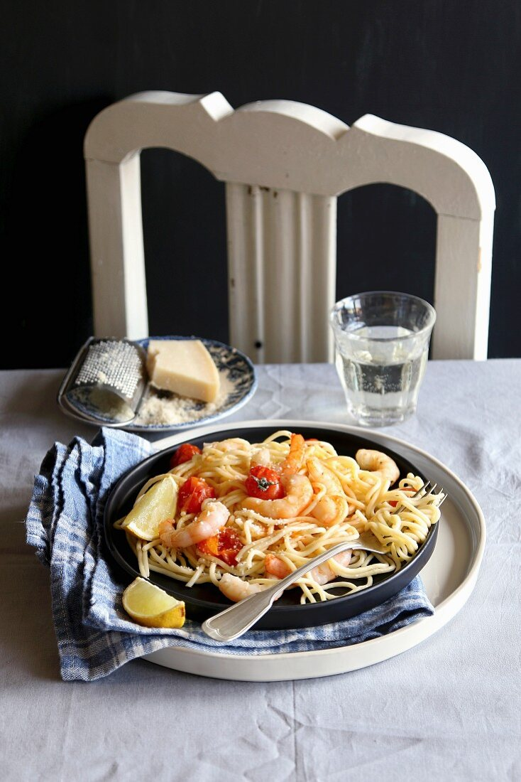 Spaghetti with shrimps, roasted tomatoes and parmesan cheese