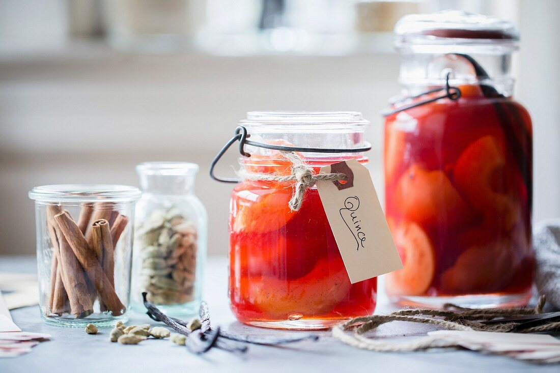 Poached Quince Fruit in a preserving mason jar