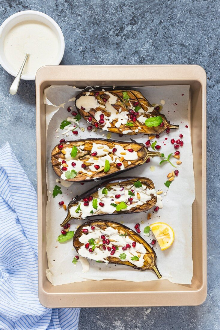 Roasted Aubergine with Tahini Dressing, pomegranate and pinenuts