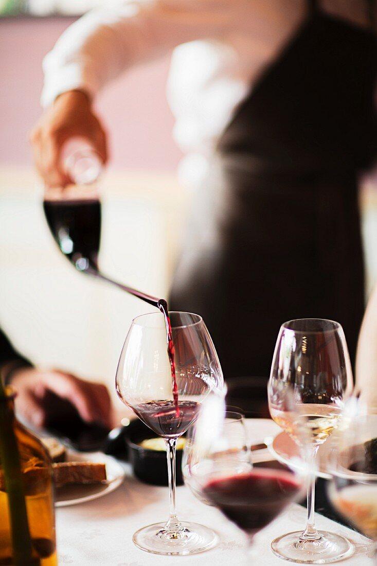 Red wine being poured into a glass, Domaine de la Romaneé-Conti, Burgundy, France