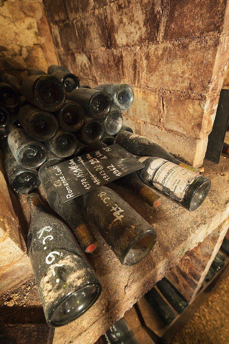 Dusty bottles of wine in a cellar on the Domaine de la Romaneé-Conti estate in Burgundy, France