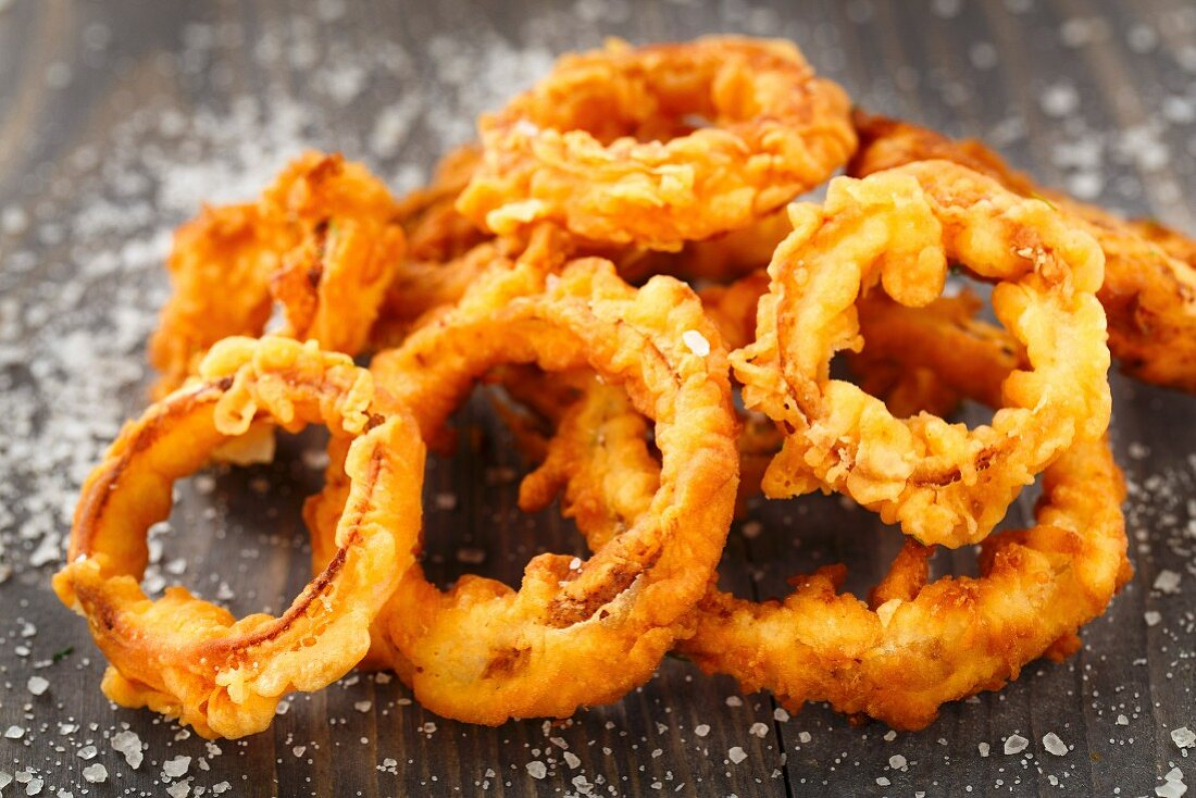 Homemade crunchy fried onion rings on a table