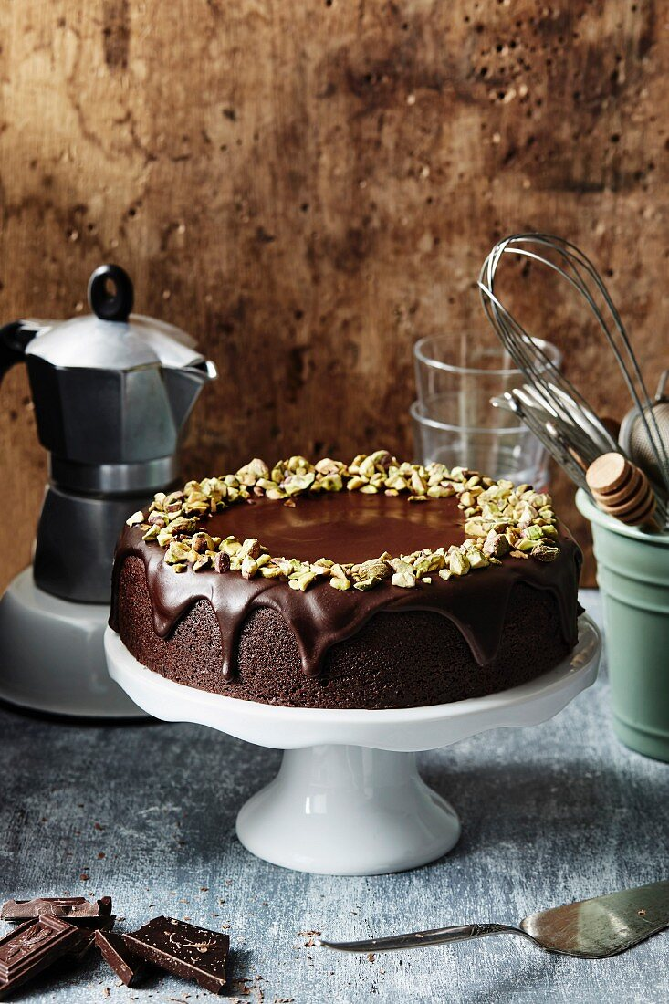 Chocolate frosted cake with chopped pistachios