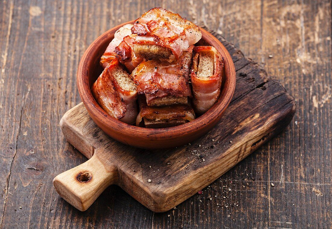 Appetizer bread slices fried in bacon