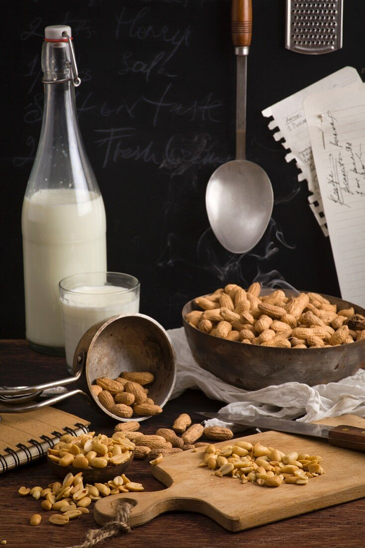 Dried peanuts and milk on table