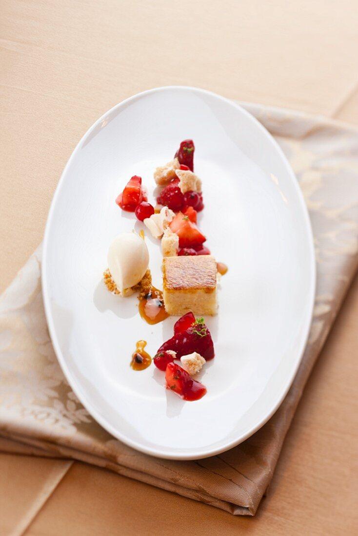 A dessert plate with berries, vanilla ice cream and fresh cheesecake