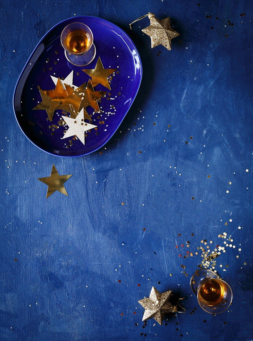 A Christmas still life with a star decoration and liqueur glasses