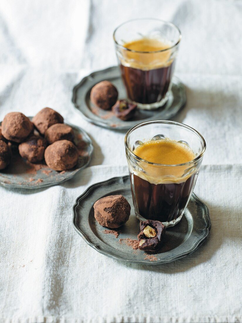 Chocolate nut truffles and coffee in a glass
