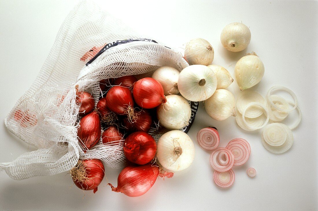 Whole Red and White Onions in a Net; Onion Slices