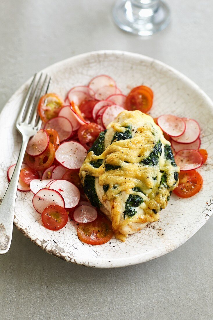 Chicken breast au gratin with spinach and ricotta filling and radish and tomato salad
