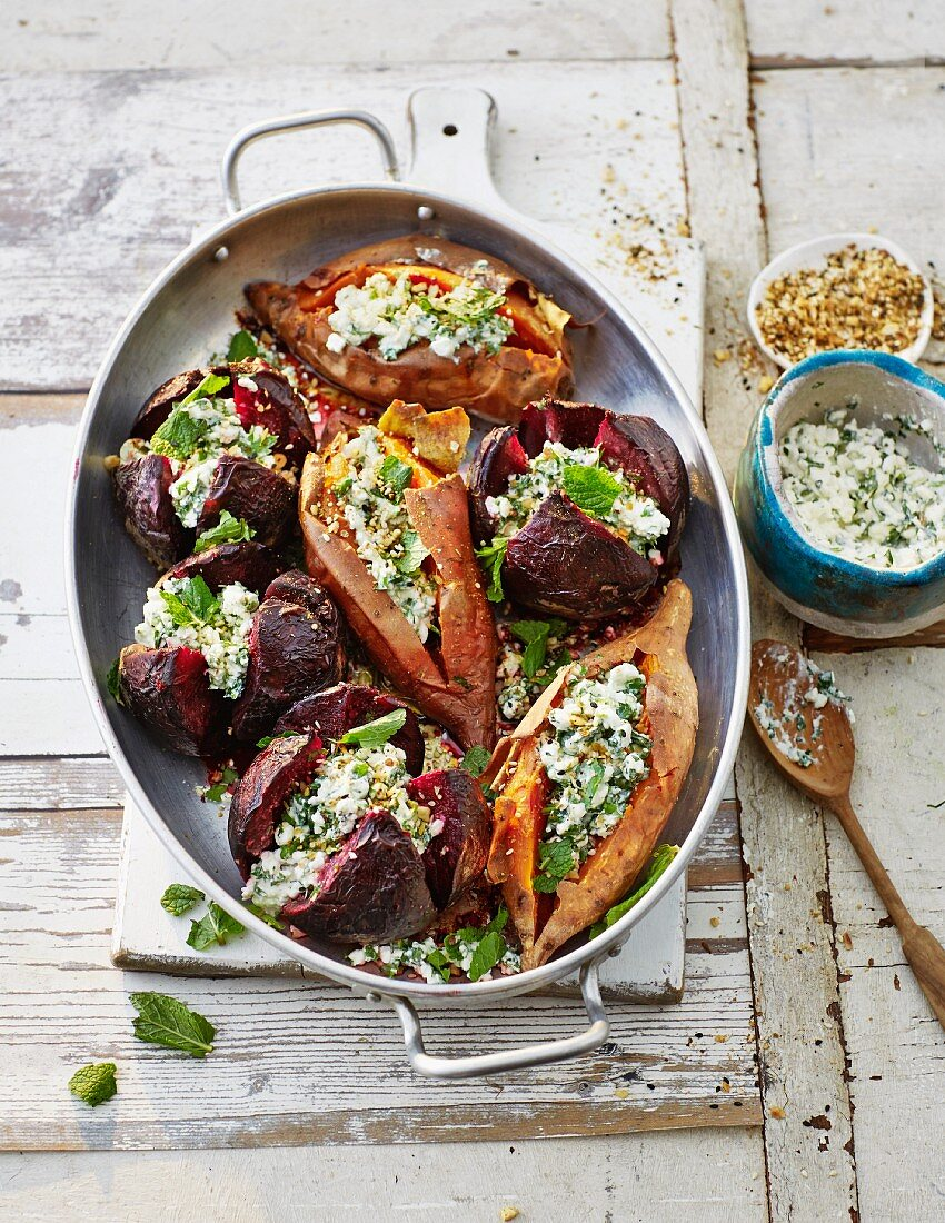 Oven-baked sweet potatoes and beetroot