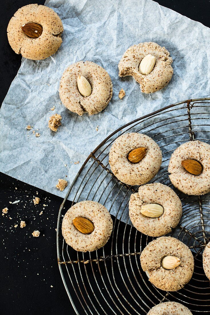 Almond biscuits on and beside a cooling rack