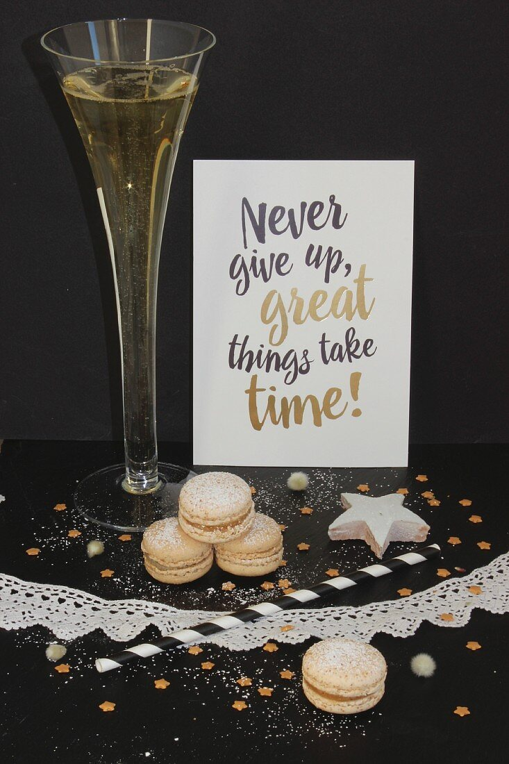 A champagne glass, christmas cookies and a New Year's eve label