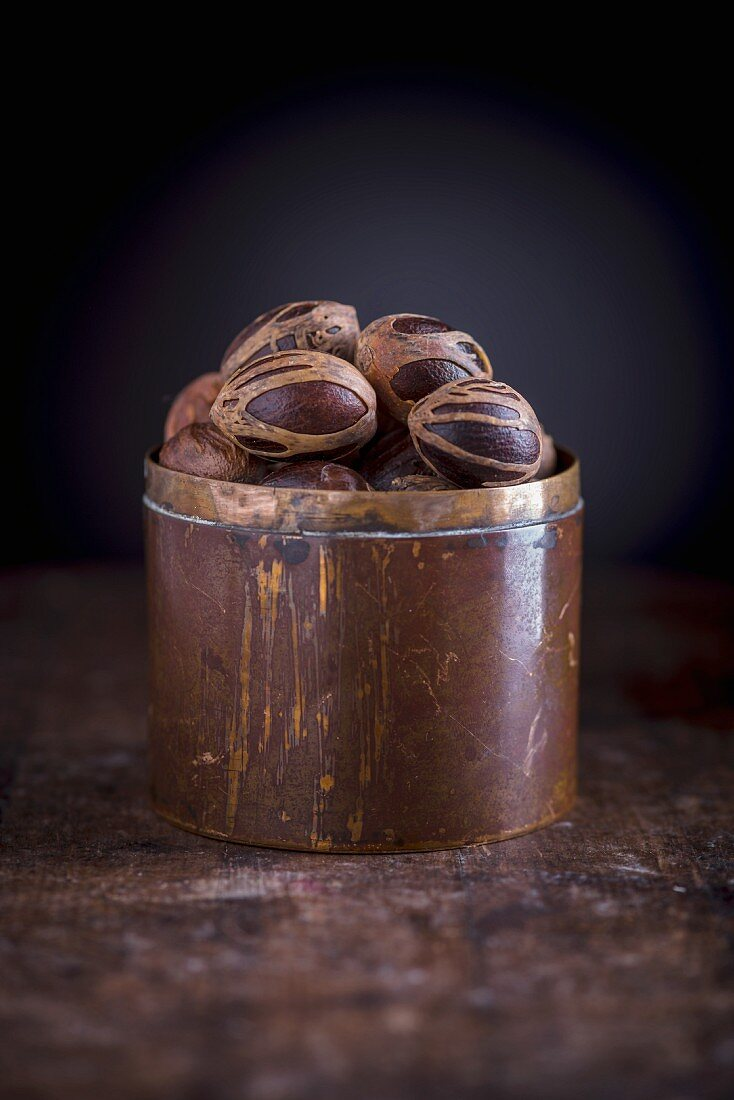 Nutmeg with mace in a copper container