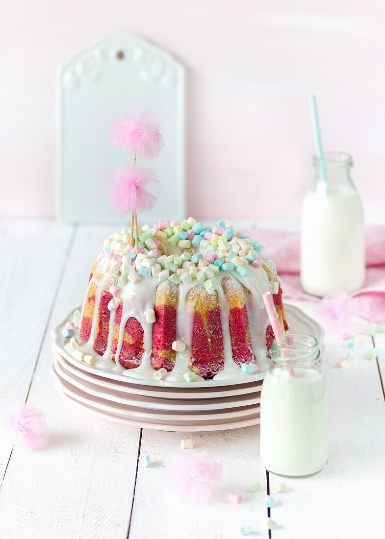 Raspberry marble gugelhupf with marshmallows for a birthday party