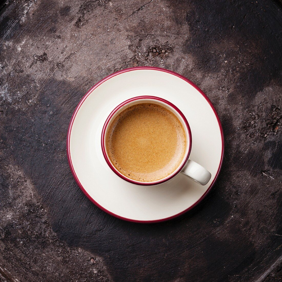 Coffee cup on dark textured background