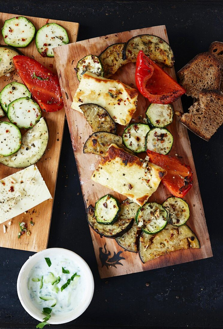Grilled cheese and vegetables on a cedar wood board
