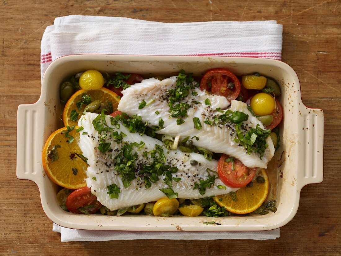 Oven baked cod with colourful tomatoes and oranges