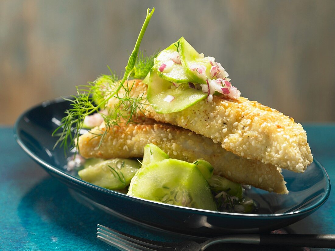 Sesame fish sticks with a spicy cucumber salad