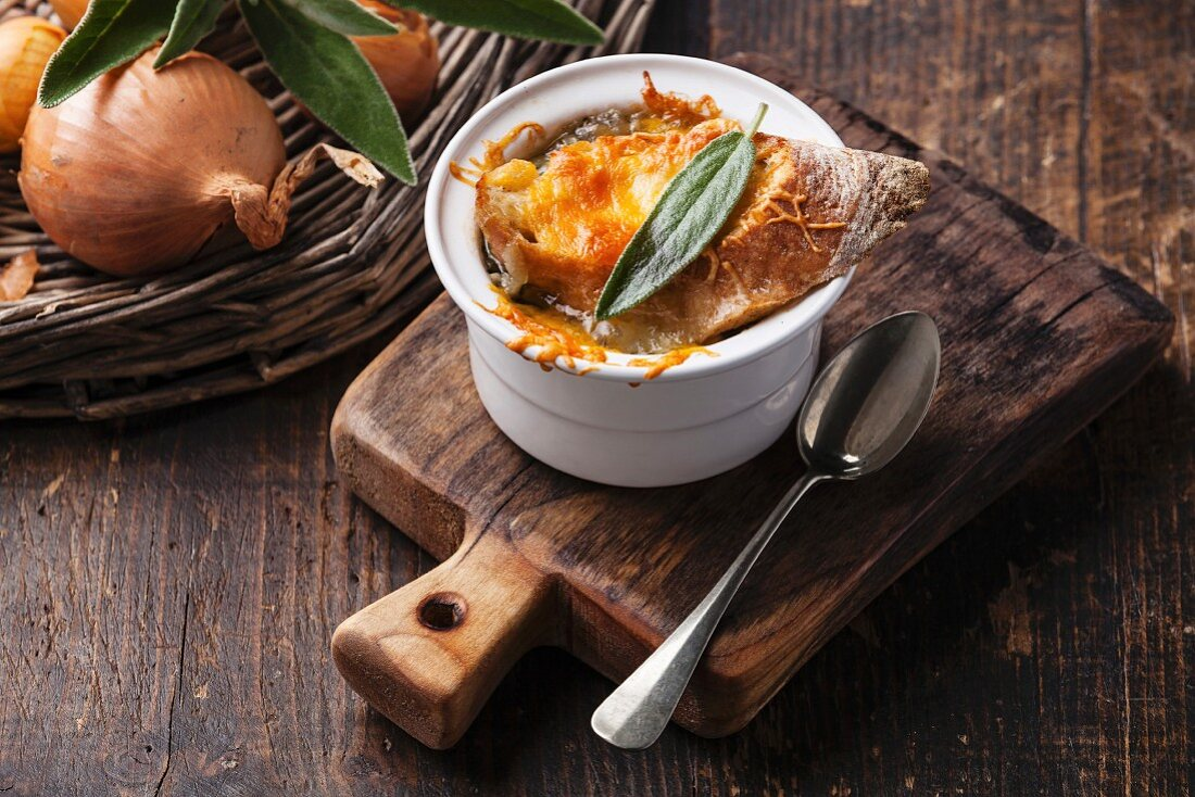 Onion soup with dried bread, sage and cheddar cheese