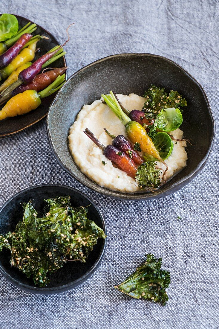 Celeriac puree with roasted carrots and kale.