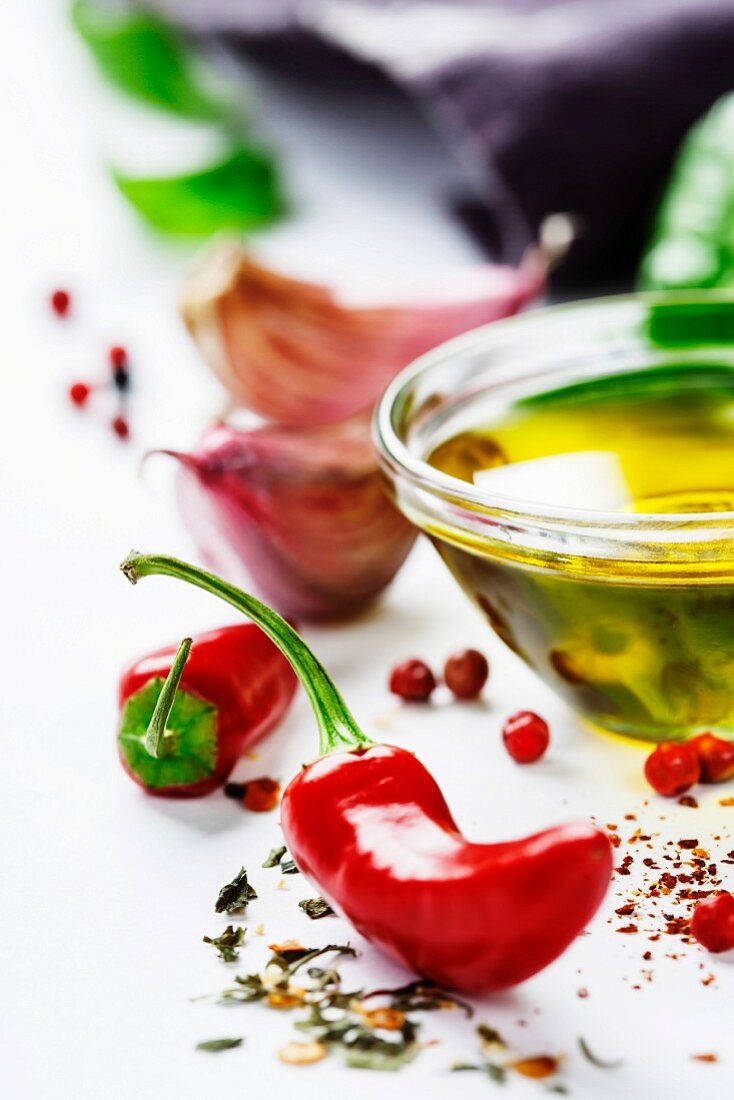Red Hot Chili Peppers with herbs and spices over white background