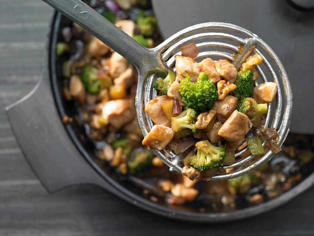 Stir fried chicken with broccoli, walnuts and oyster sauce