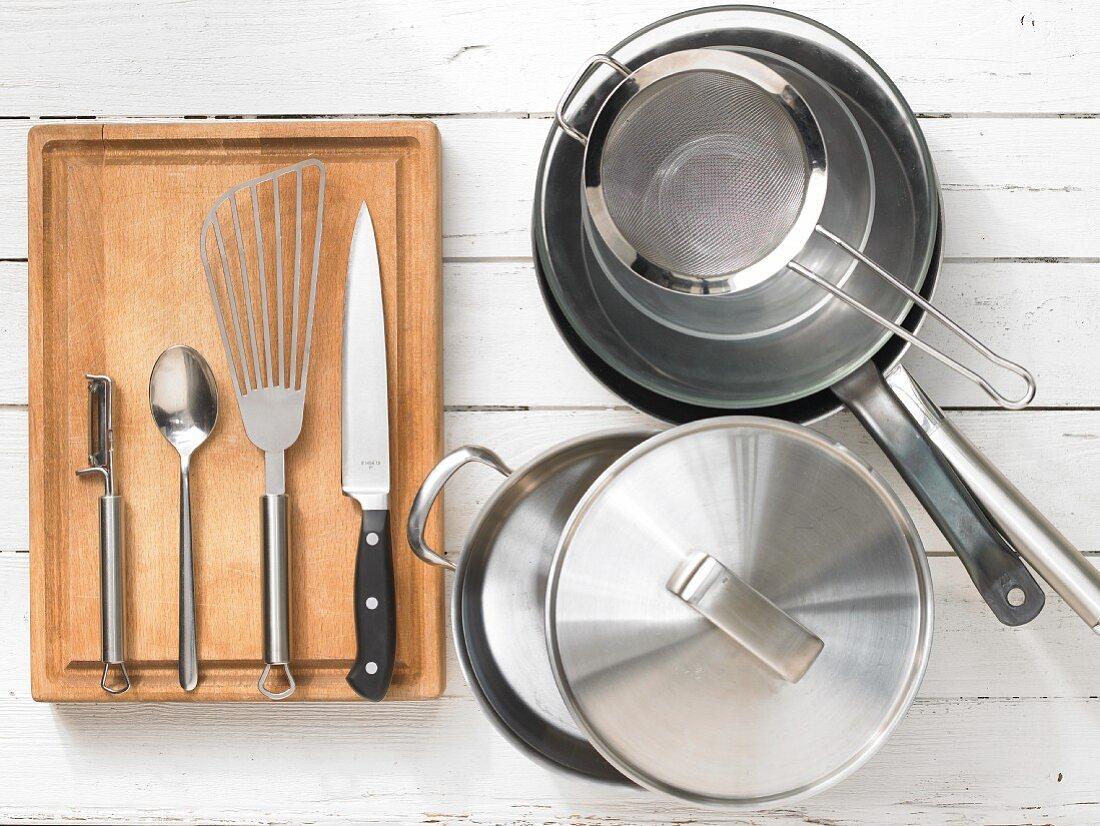 Various kitchen utensils: pot, pan, sieve, spatula