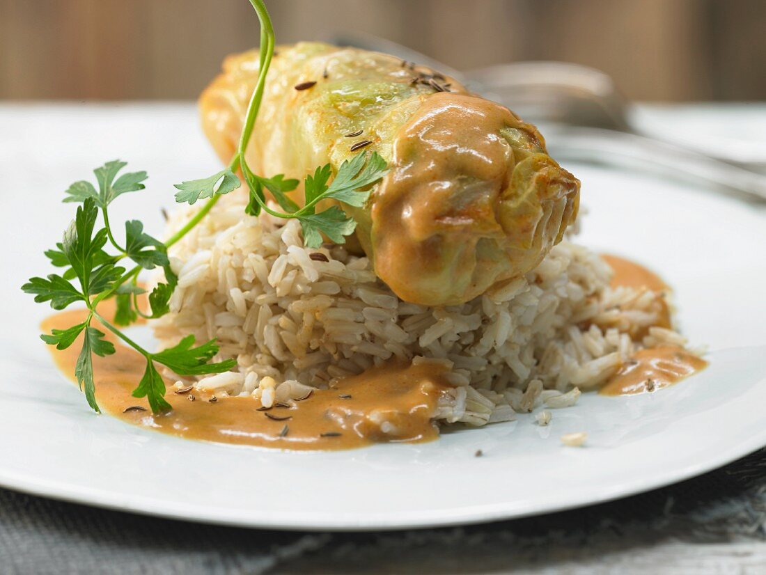 Cabbage rolls with veal, capers, garlic and caraway on rice