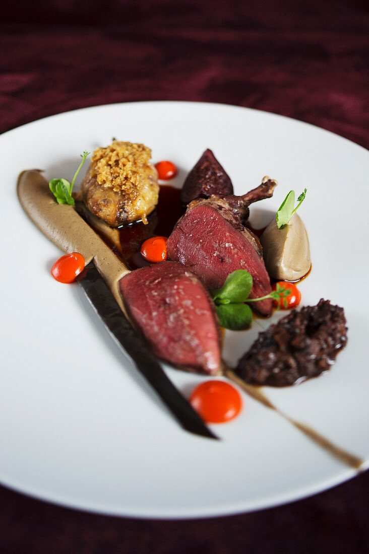 Pigeon étouffé with aubergine, fig and ras el hanout from the 'Heldenplatz' restaurant in Hamburg, Germany
