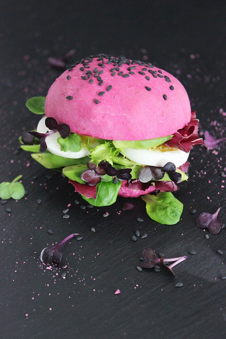Pink burger with avocado and egg