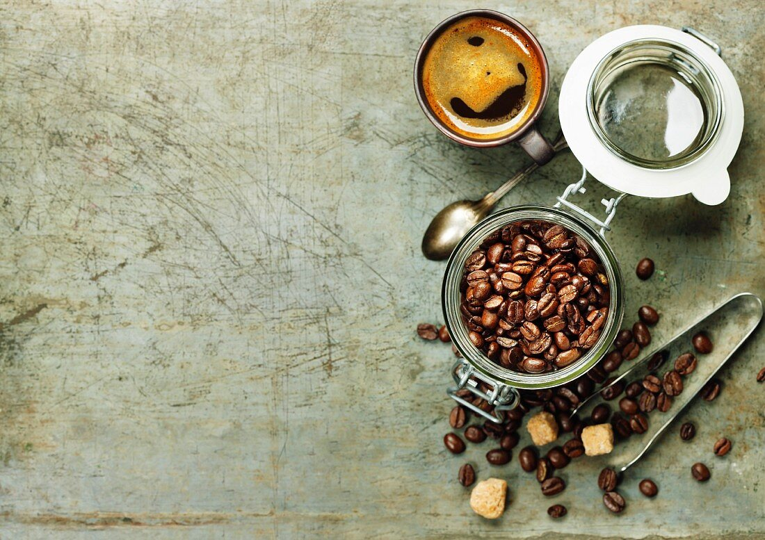 Espresso and coffee beans on vintage background