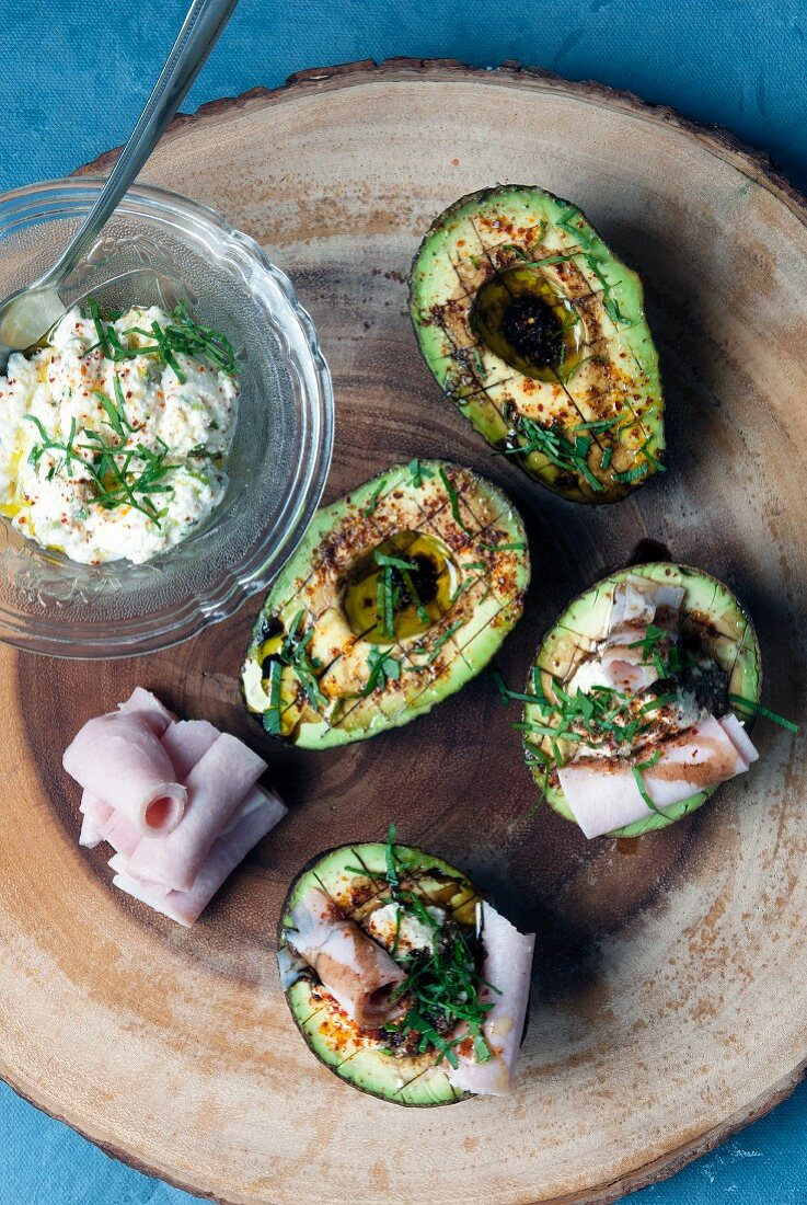 A light lunch of avocado served with rolled ham slices