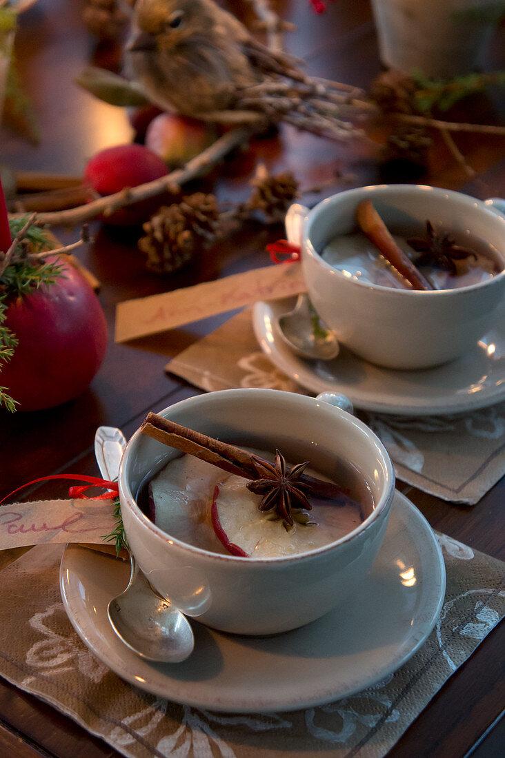 Apple tea with dried apple slices, star anise and cinnamon sticks
