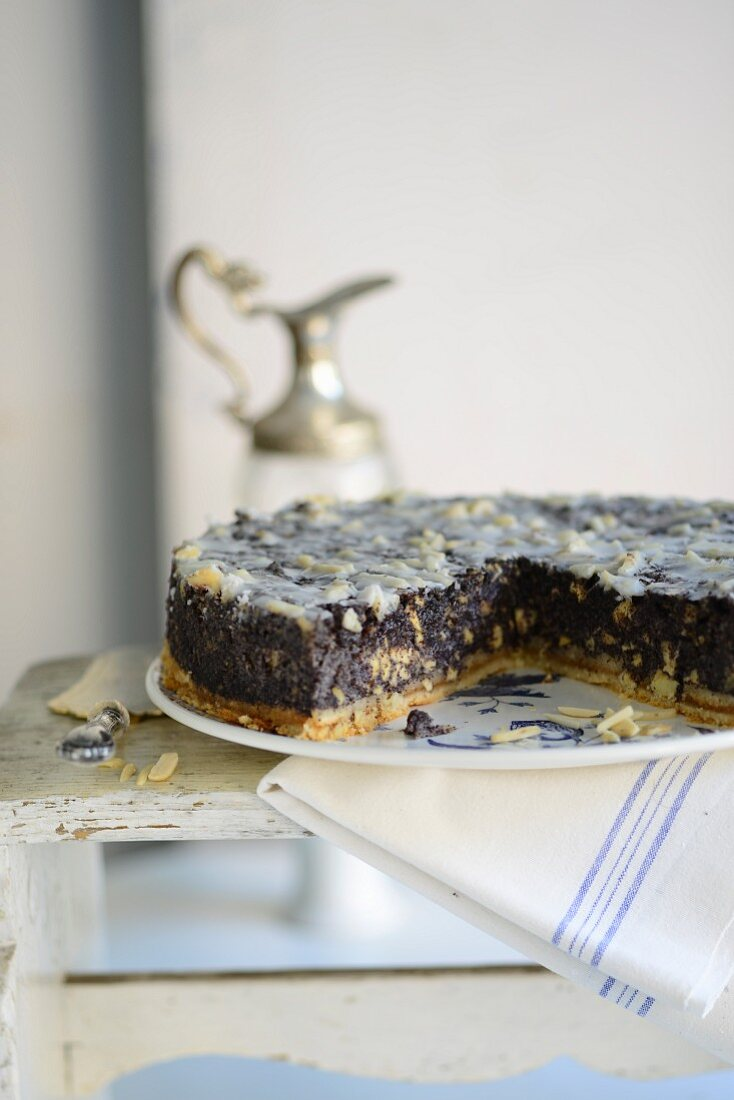 Poppy seed tart with almonds, sliced