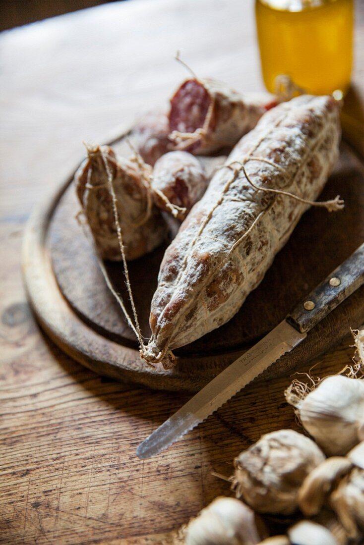 Salami on a wooden cutting board