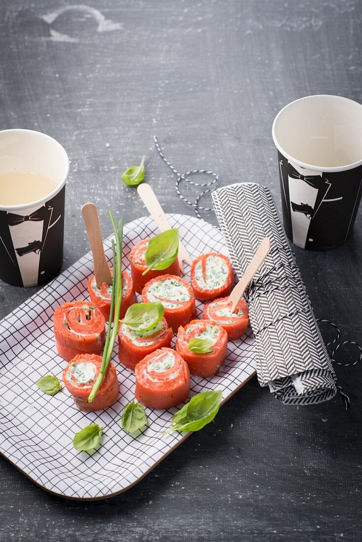 Salmon rolls with fresh cheese and basil