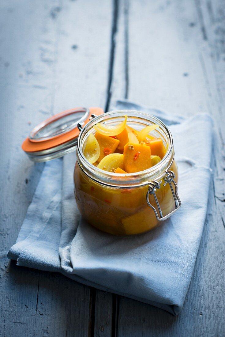 Pickled sour pumpkin in a glass jar