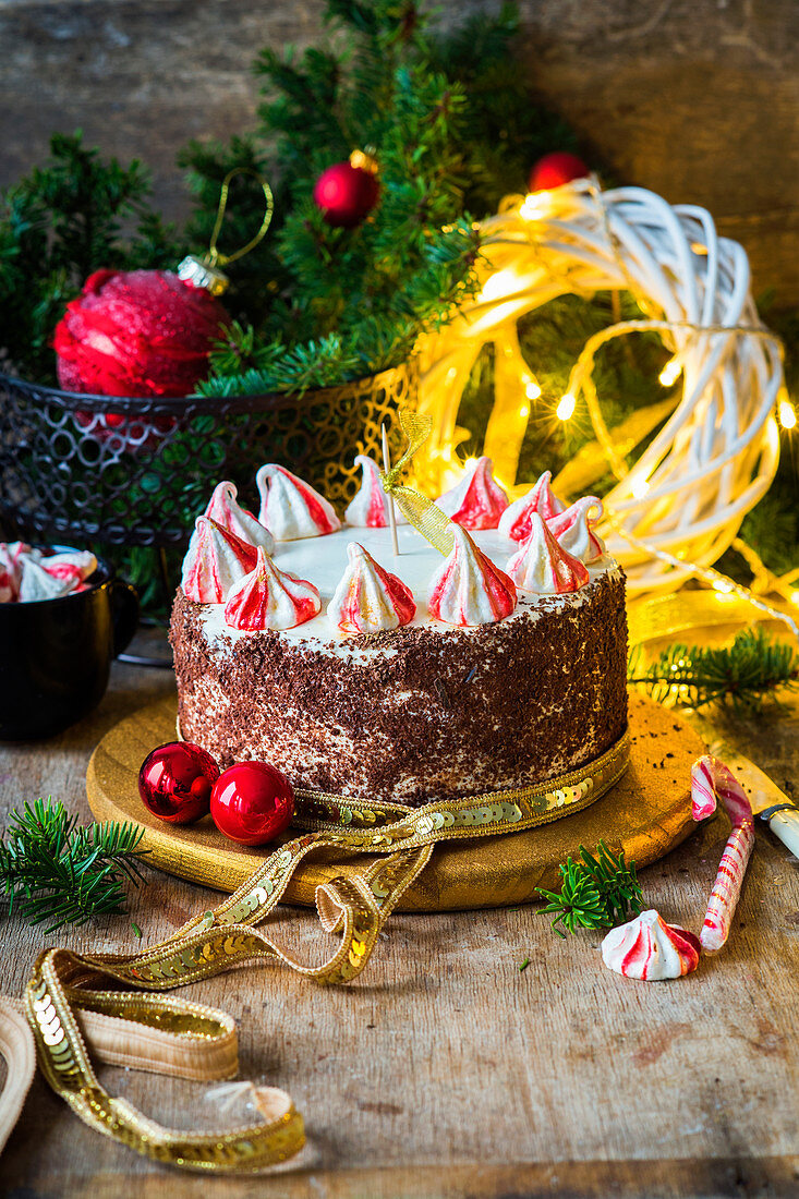 A Christmas cake on a wooden plate